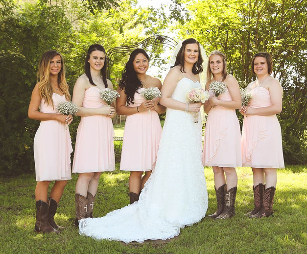 These bridesmaids having matching hemlines is a small detail, but it look so good in photos!. Good job Kaylee!