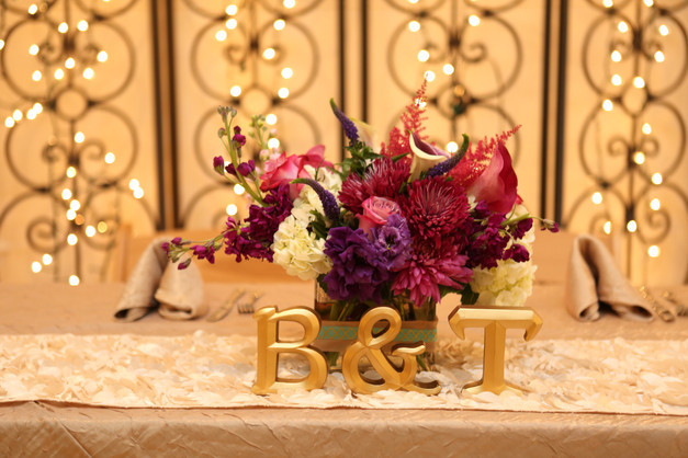 Bright arrangement on the sweetheart table.