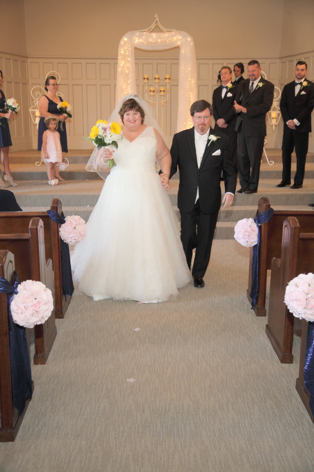Coming down the aisle as Mr. and Mrs.