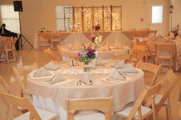 Elegant gold linens on the tables in the reception hall