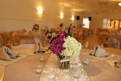 Floral Centerpieces on our Cream Rosette Runner