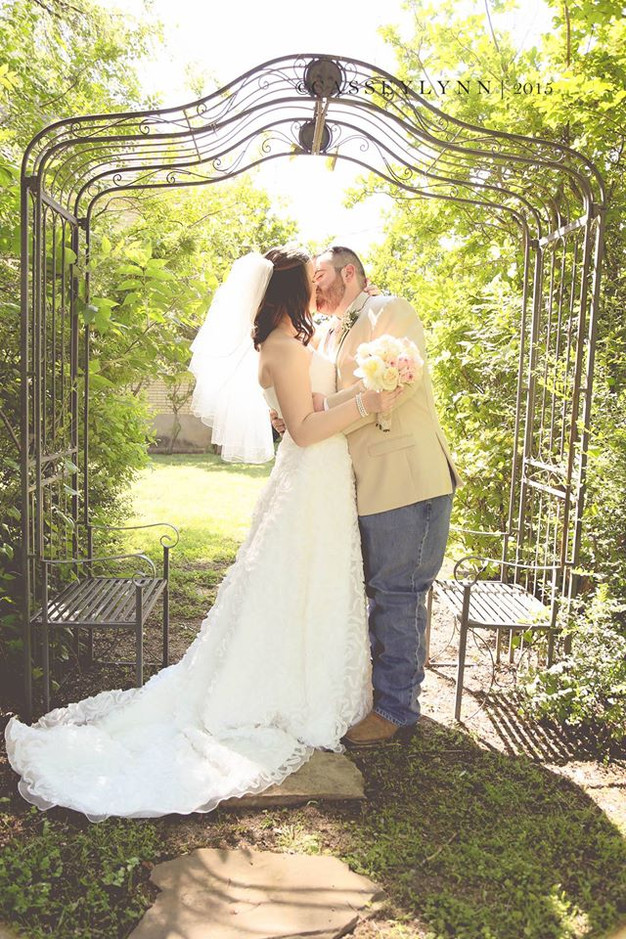 Kissing under our outdoor arbor