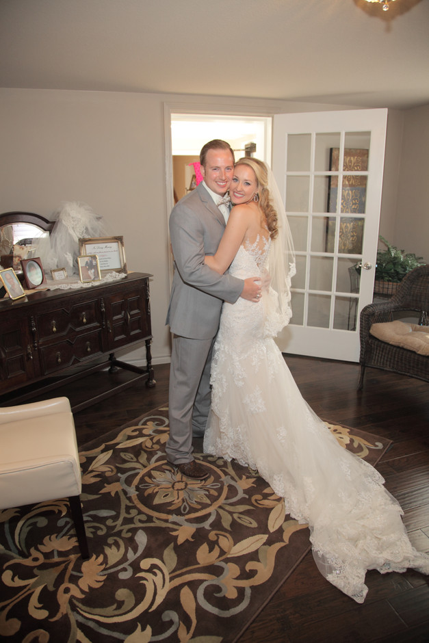 Tarin and Brian in the Receiving Room moments after coming down the aisle.