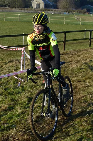 Cyclist on a muddy course