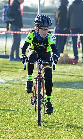 Tom Lewis riding down the finishing straight in the U12s race.