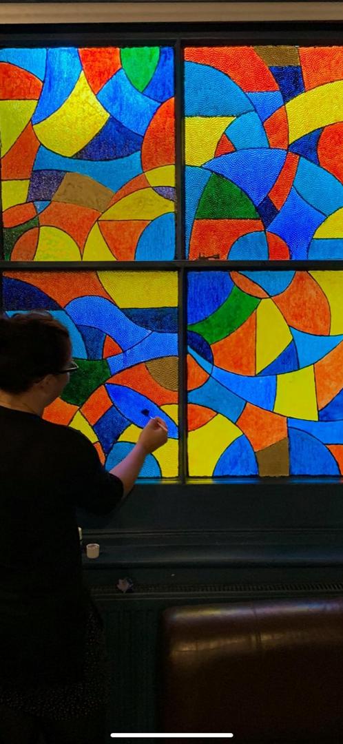 Jenny painting the window