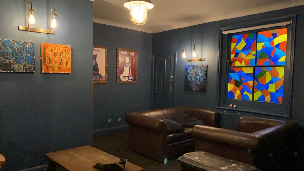 Window and art on our blue walls
