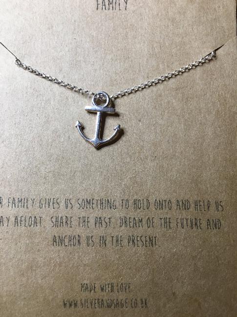 A silver anchor pendant