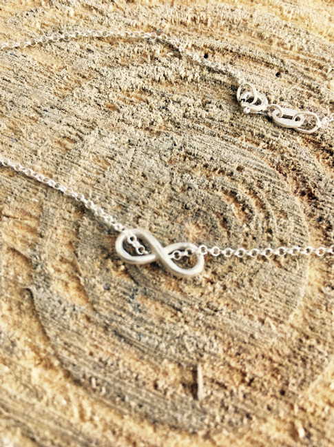 Infinity sterling silver necklace or bracelet