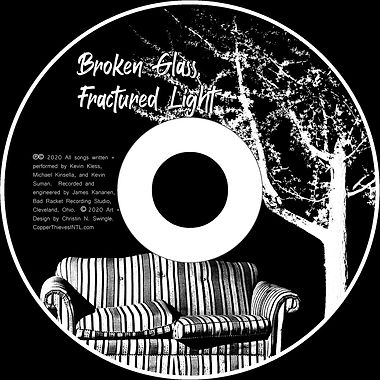 Image of CD disk; black and white with a couch and white tree.  Album title: Broken Glass, Fractured