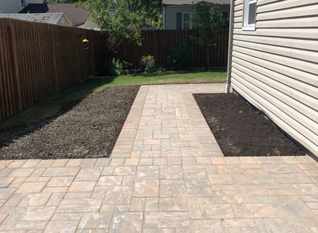 The Benefits of Patios and Walkways on Your Property