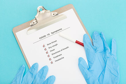 checklist-on-clipboard-with-covid-19-sym