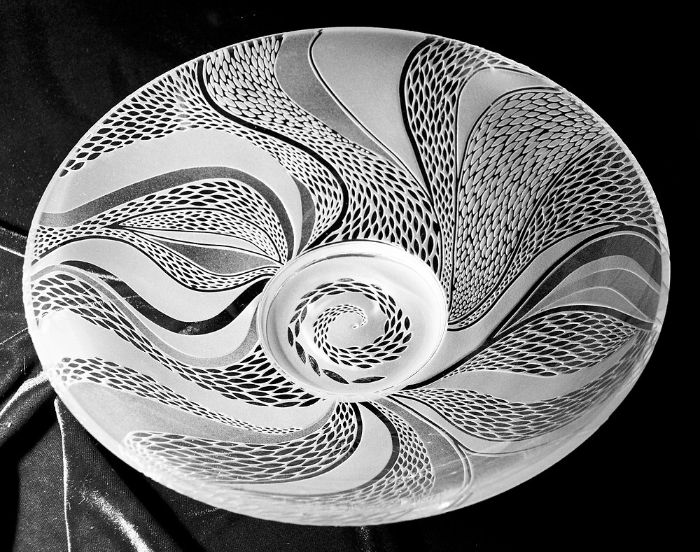 """12"""" clear glass bowl with flowing leaf design."""