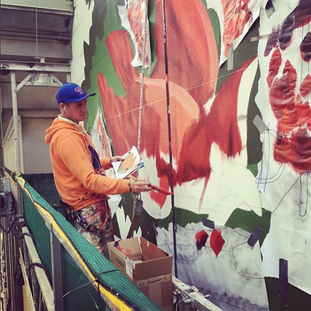 Jeff on the scaffolding installing the 13k square foot Kerry James Marshall during the Cubs playoffs.