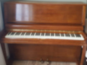 front of oak piano re polished