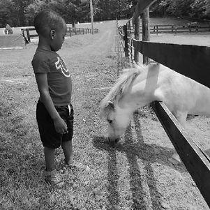 B&W boy with pony.jpg