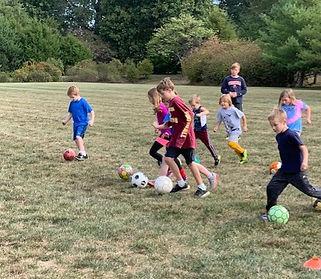 Kids running soccer drill_edited.jpg