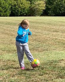 Girl kicking soccer ball_edited.jpg