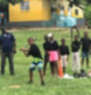 Jamaica boy batting.jpg