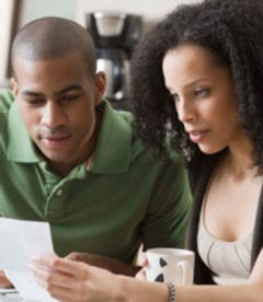 Couple reading their handwriting report.