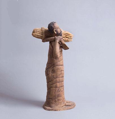 פסל איכר מקושש עצים
