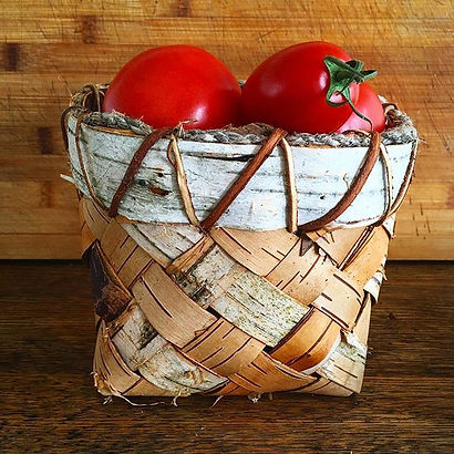 Plaited birch bark basket, rim sewn with
