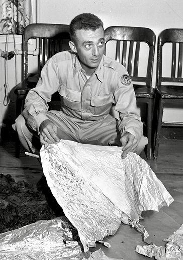 Jesse Marcel Sr. holding Roswell debris