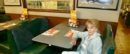 Joann in booth, enhanced with Photos.png