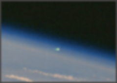 Green fireball leaving Earth