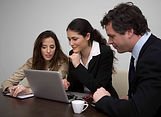 3 professionals collaborating at compute.