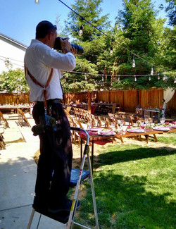 Greg Landeros photographing event details