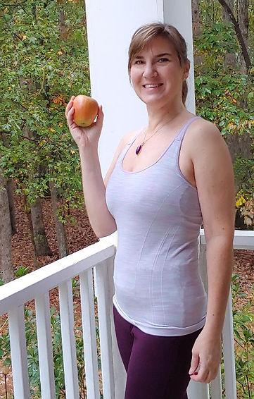 holding apple cropped 1.jpg