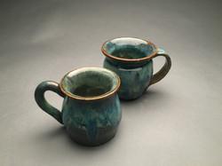 2 of 4 thrown mugs