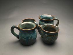 4 thrown mugs: view 1