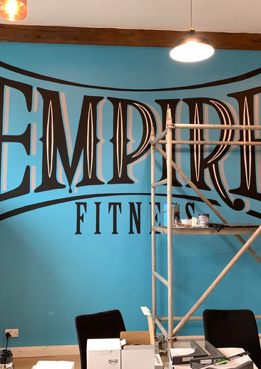 I've been going to Empire Fitness for over half my life, so when it changed hands and the new owner wanted a fresh identity, I was thrilled that he asked me.  The logo was designed in pencil, roughed out in Procreate, built in Illustrator then applied, social distancing made easier with a scaffold, to the reception wall in the middle of lockdown.