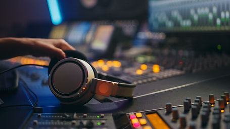 Close-up Shot of a Headphones lying on M