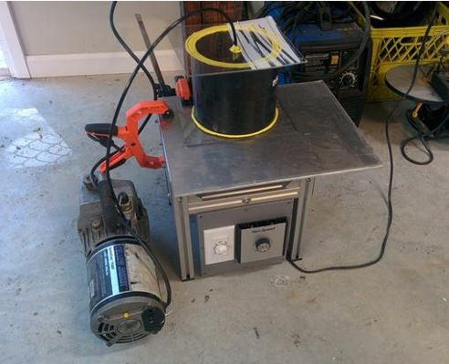vacuum system being used on epoxy granite mixture to remove air