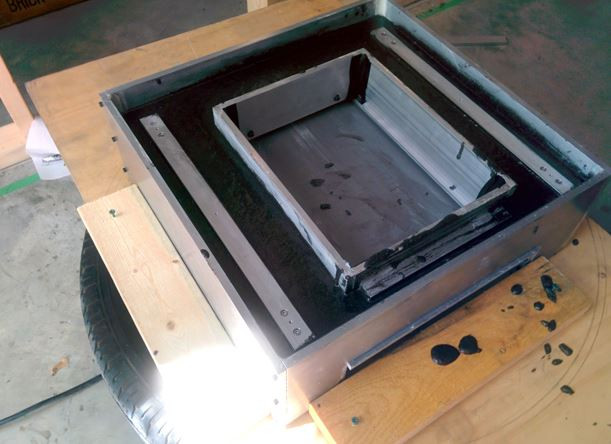 Epoxy granite cast into the mold and on the vibration table