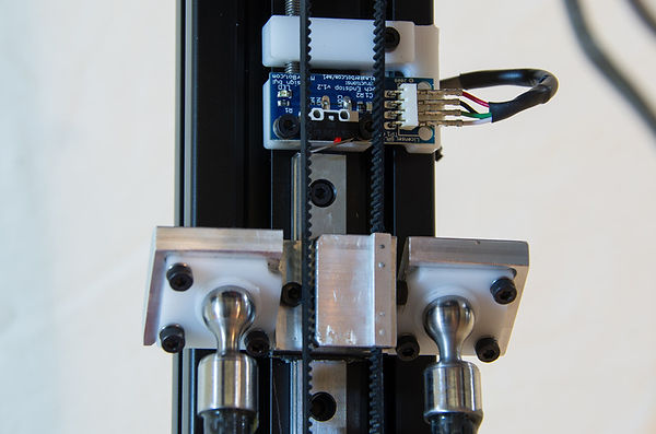 Flexure based adjustable end stops on 3d delta printer