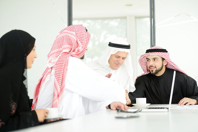 Successful Arabic business people shakin