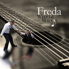 Freda_on_Guitar_hair_copy.jpg