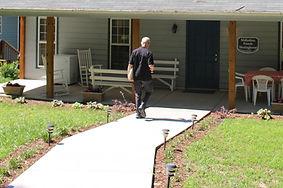 Concrete walkway leads directly to front door