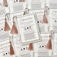 Bundle wedding invite in pale silvers and a touch of dusky pink with vellum wrap