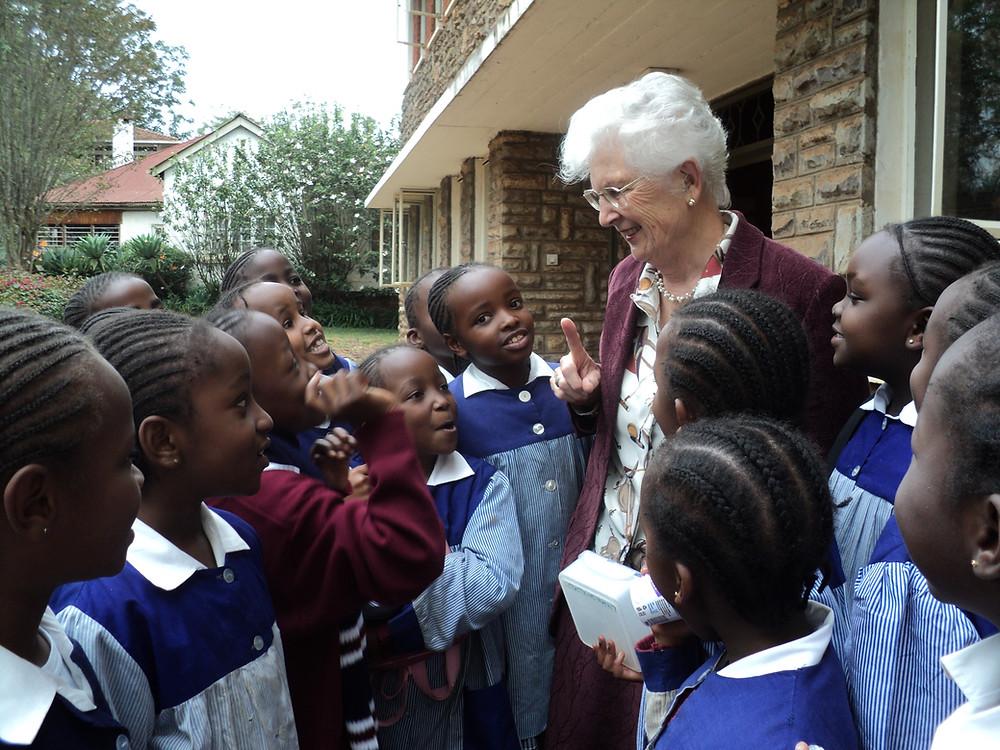 Olga outside the lower primary building with Kianda School girls