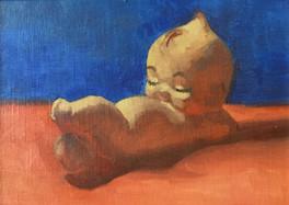 Kewpie Reclining
