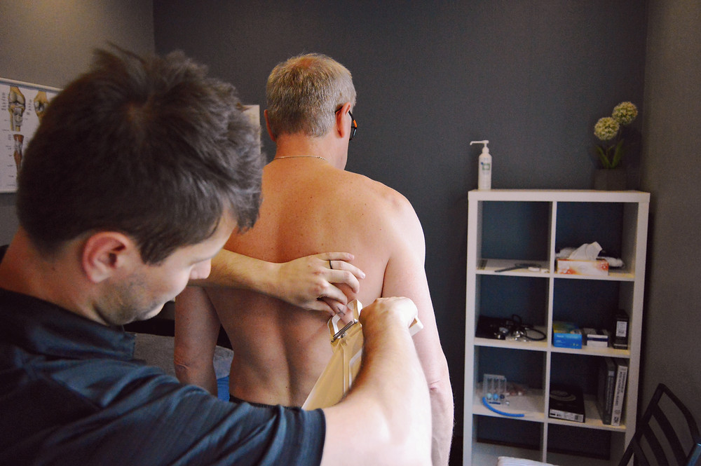 Taking skinfold measures at specific areas on the body.