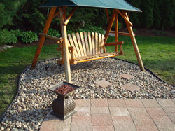 Backyard Swing Area with Stone