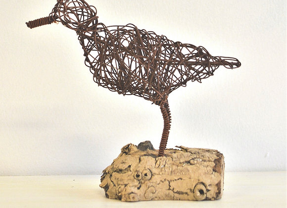 Wire bird with driftwood stand