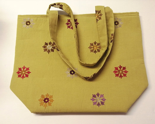 Mustard yellow large shopper bag with embroidered detail.