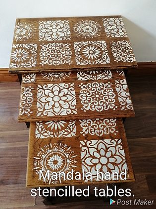 Oak nest of tables with white hand stencilled mandala designs